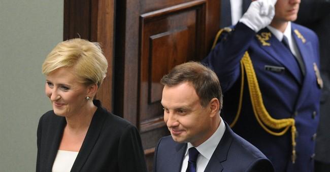 Poland's conservative president, Andrzej Duda, takes office