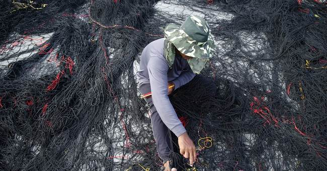 Image of Asia: Making repairs in port before taking shelter