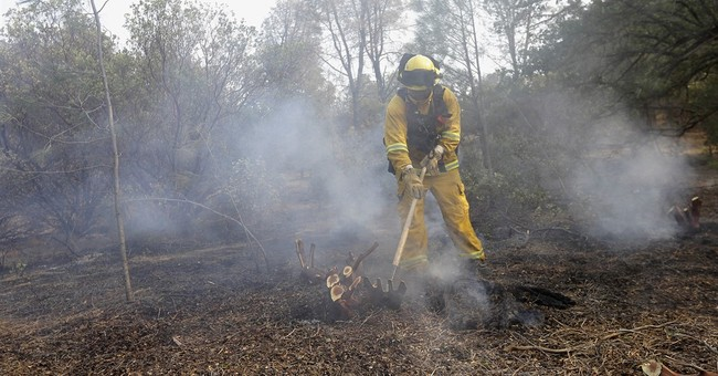 The Latest: Wildfire evacuees begin to trickle back home