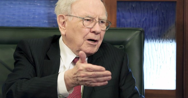 Buffett's company reports 37 percent drop in 2Q earnings