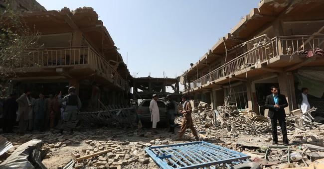 Kabul blasts kill 35, test Afghan president's peace plan