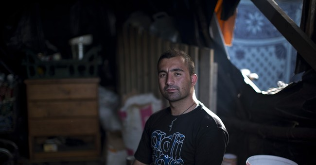 Huge migrant camp in Calais takes on air of permanence