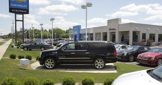 Cadillac wants small dealers to upgrade to 'boutique' stores
