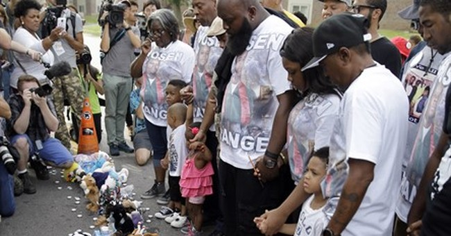 Pig's head used in Ferguson anniversary protest