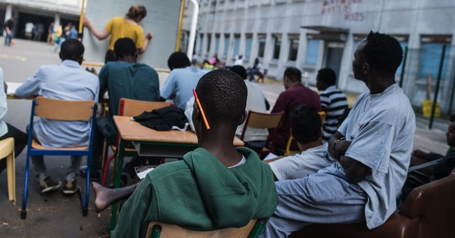 Paris turning schools, hotels into housing for migrants