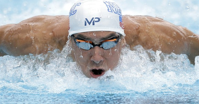 Phelps answers Le Clos' taunts with faster time in 100 fly