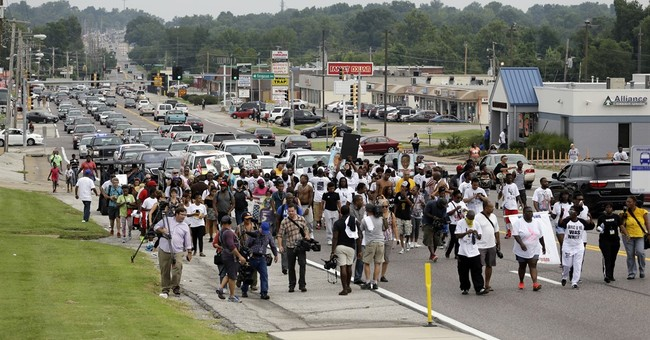 The Latest: Police confirm shooting at Ferguson protest