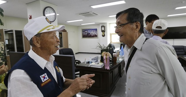 Retracing war past, ex-N. Korean POWs return to South Korea