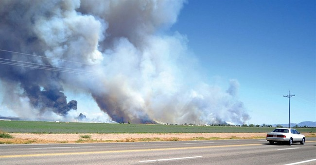 Wildfire burning near massive blaze expands