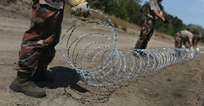 Farmers give melons to troops building Hungary border fence