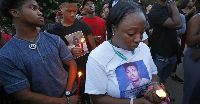 The Latest on athlete's death: Dozens demonstrate in protest