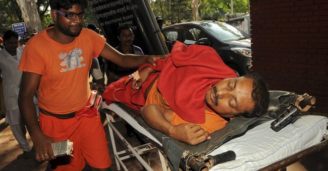 Stampede at Indian temple leaves 10 dead, dozens hurt