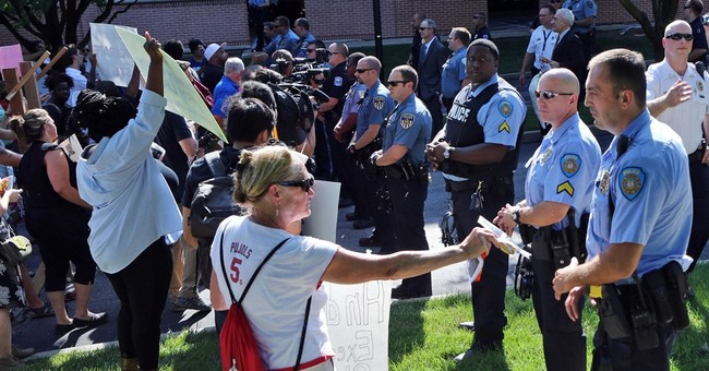 Protesters gather in Ferguson for peaceful demonstration