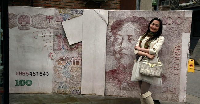 Q&A: What yuan devaluation means for China, other countries