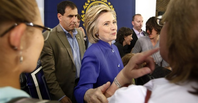 Clinton relents, gives up possession of private email server