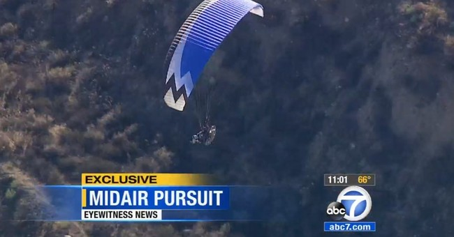 Paraglider prompts sky chase after jail flyover