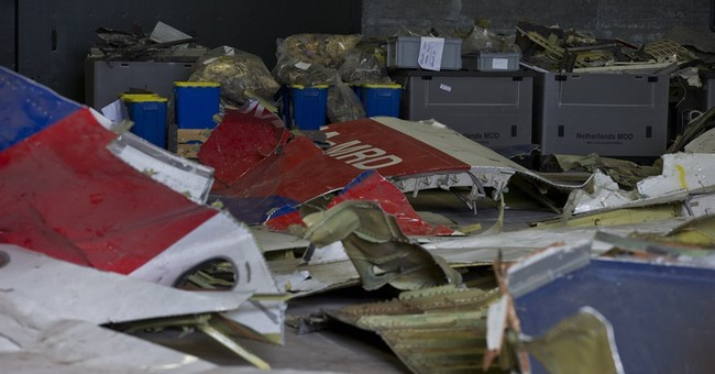 Prosecutors: Possible Buk missile parts found at MH17 site