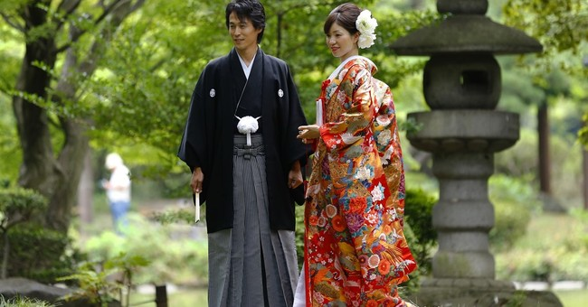 Image of Asia: Posing for wedding photos in Hibiya Park