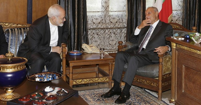 Deadly attacks surge as Iran's foreign minister visits Syria