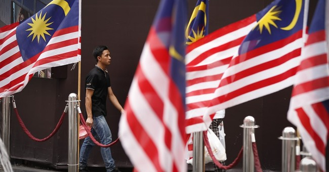 Opposition party sues Malaysian PM over $700M in donations