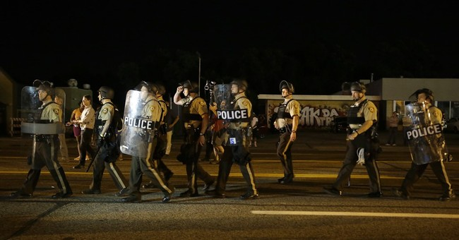 The Latest on Ferguson: Crowd thins along West Florissant