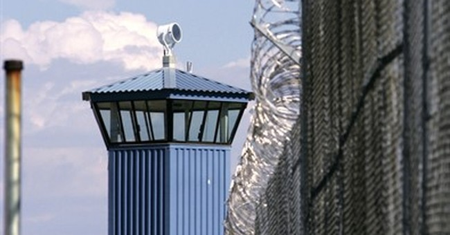 Slaying casts pall on plan to reduce solitary confinement