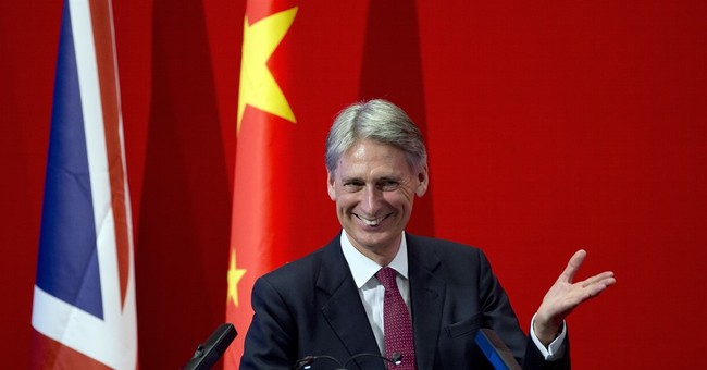 Britain's Hammond in China for security, climate talks