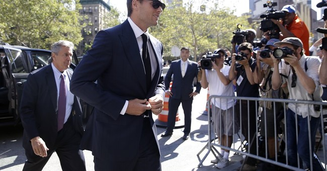 The Latest: Brady, Goodell leave court after hearing, talks