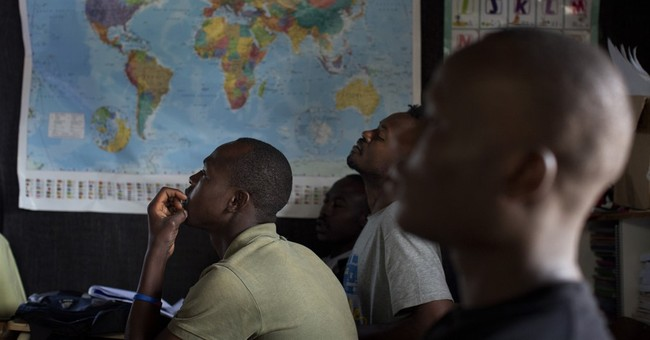 Migrants flock to tiny school built by 1 of their own