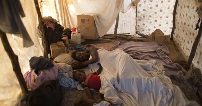 AP PHOTOS: Migrants flee Dominican Republic, land on border