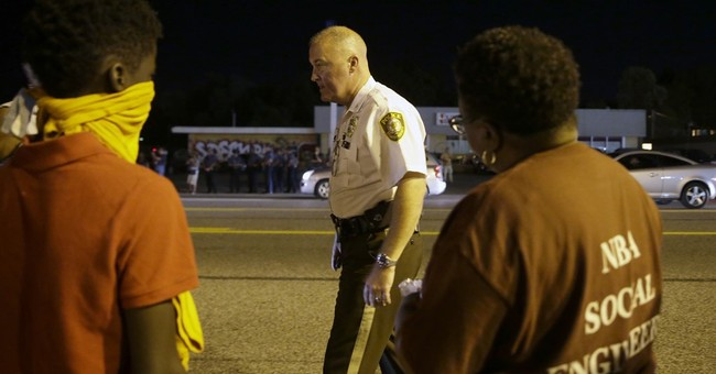 The Latest on Ferguson: Father expects Harris to survive