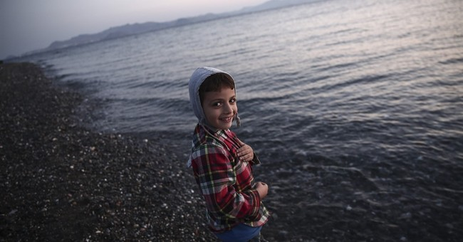 As conditions worsen, Greece promises ship to house refugees