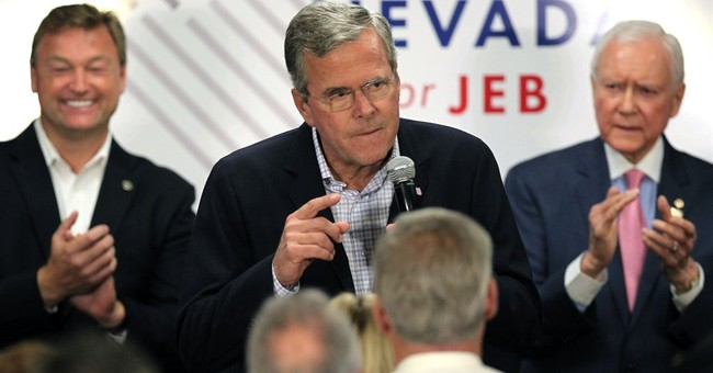 In Nevada, Bush says key to winning is to campaign with joy