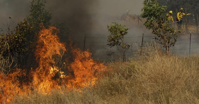 At least 150 people evacuated as wind pushes California fire