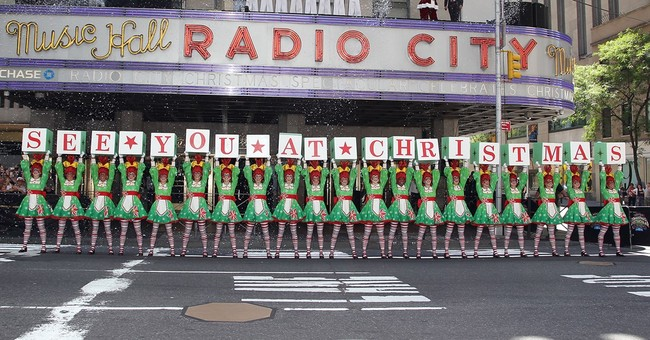 Santa Claus and Rockettes stop NYC traffic to publicize show