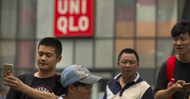 Beijing police: Man fatally stabs woman, injures French man