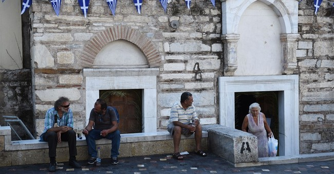 Greek government defends bailout deal ahead of vote