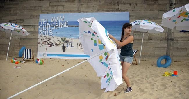 Paris beach event honors Tel Aviv, amid extra security
