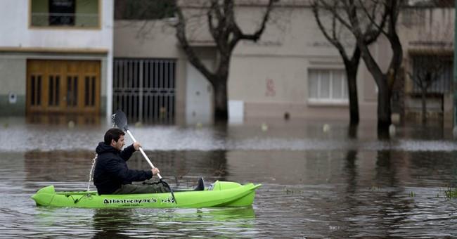 Argentine presidential candidate confronts floods, critics