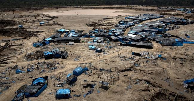 AP PHOTOS: Raids disrupt, but don't eradicate illegal mining