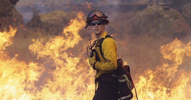 Bad fire season running through US firefighting budget