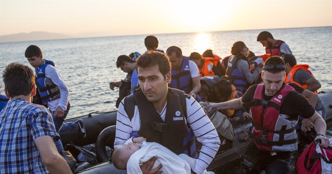 Greek police on Kos race to ease number of stuck refugees