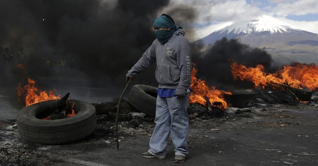 Ecuador's Cotopaxi volcano spews ash just south of Quito
