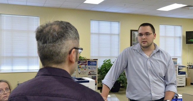 The Latest: Clerk's lawyers in gay marriage case want stay