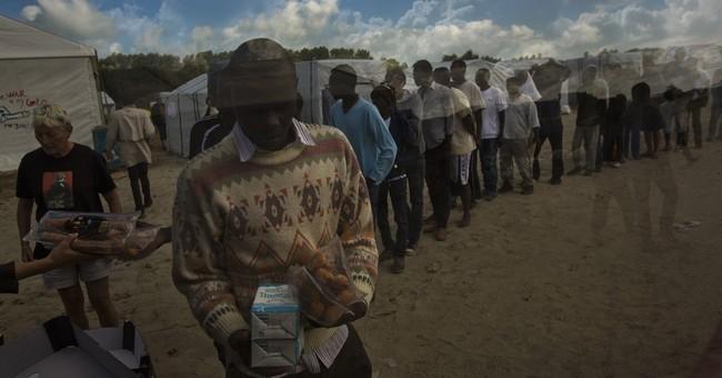 AP Photos: Calais migrants endure misery of 'jungle' camps