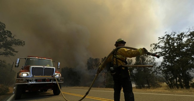Western wildfires: Wind, heat, dry land fueling large blazes