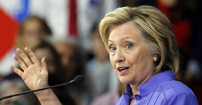 Clinton offers forceful defense on Benghazi, emails