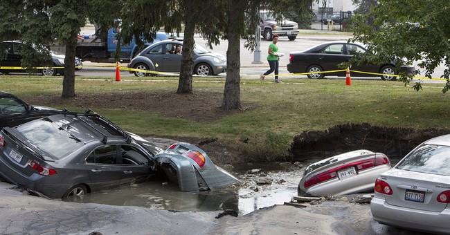 Water pipe breaks creating sinkhole that swallows cars