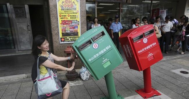 Bent in Taiwan storm, 2 mailboxes become celebrities