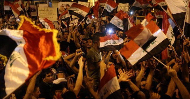 Thousands of Iraqis rally in support of government reforms